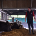 Livestock Consultant Robert Ramsay walking through a cattle shed